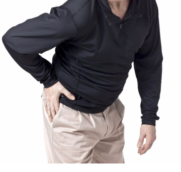Photograph of of man holding hip because of hip pain